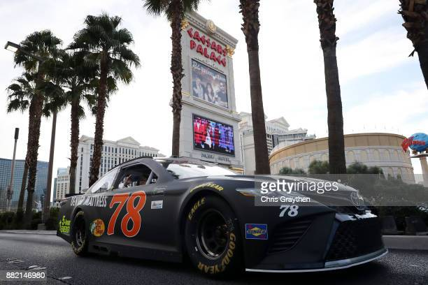 Monster Energy NASCAR Cup Series champion Martin Truex Jr driver of the Furniture Row/Denver Mattress Toyota drives during the NASCAR Victory Lap...