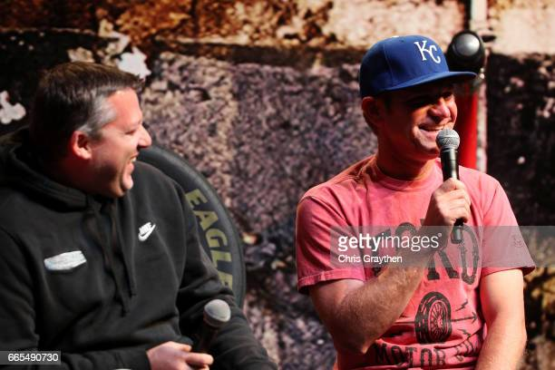 Monster Energy NASCAR Cup Series driver Clint Bowyer laughs on stage with former NASCAR driver Tony Stewart during the Texas Motor Speedway FANDAGO...