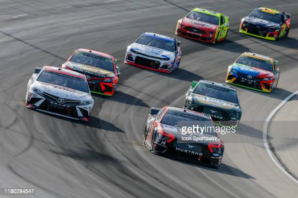 Monster Energy NASCAR Cup Series driver Clint Bowyer leads a pack of cars through turn two during the Monster Energy NASCAR Cup Series AAA Texas 500...