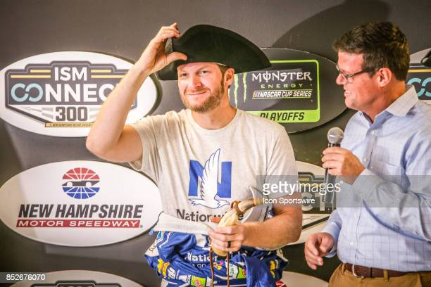 Monster Energy NASCAR Cup Series driver Dale Earnhardt Jr is presented with gift hat during press conference prior to qualifying for the NASCAR...
