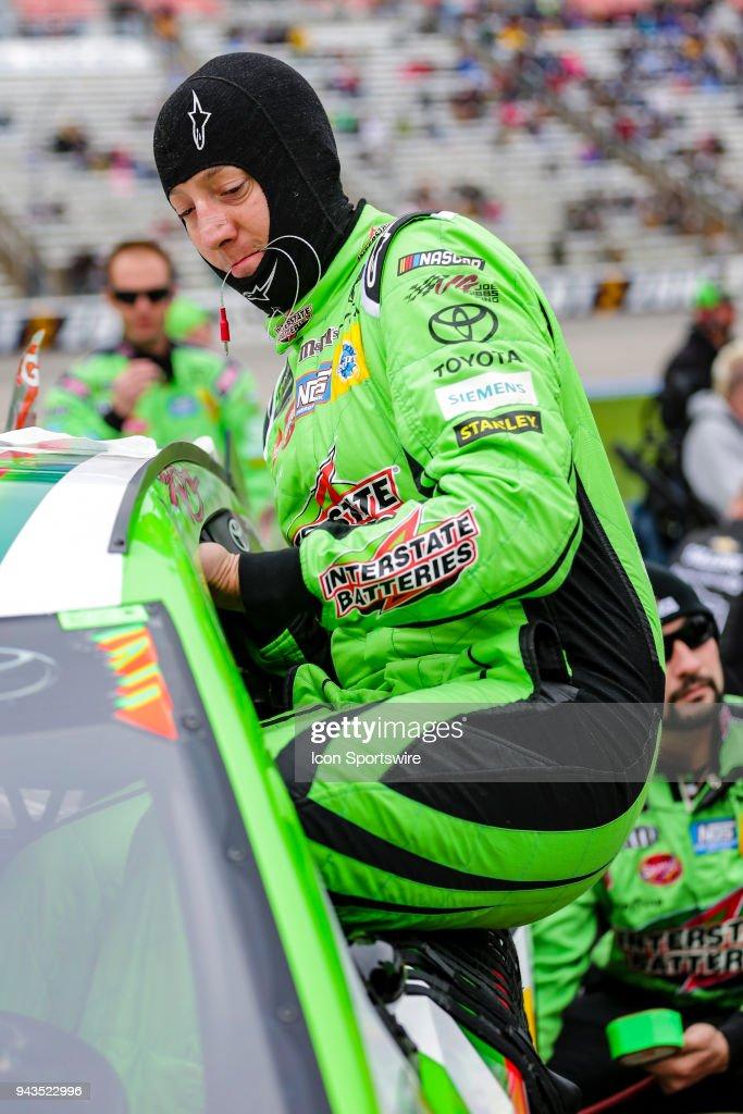 Monster Energy NASCAR Cup Series driver Kyle Busch climbs