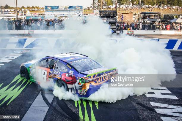 Monster Energy NASCAR Cup Series driver Kyle Busch does a burnout after winning the NASCAR Monster Energy Series ISM Connect 300 playoff race on...