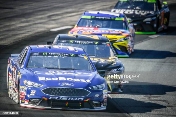 Monster Energy NASCAR Cup Series driver Matt DiBenedetto leads pack into turn 1 during the NASCAR Monster Energy Series ISM Connect 300 playoff race...