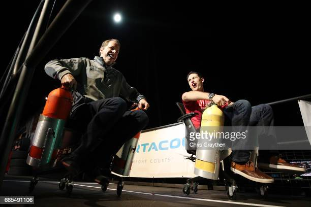 Monster Energy NASCAR Cup Series drivers Brad Keselowski and Joey Logano race with office chairs during the Texas Motor Speedway FANDAGO event at...