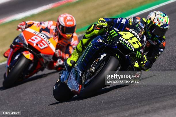 TOPSHOT Monster Energy Yamaha Italian rider Valentino Rossi and Repsol Honda Team Spanish rider Marc Marquez steer their motorbikes during the Q2...