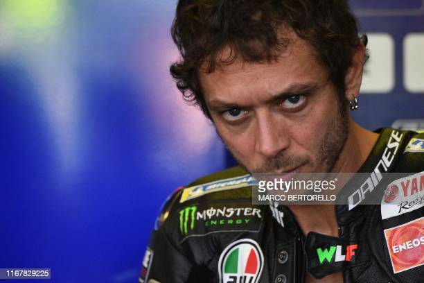 TOPSHOT Monster Energy Yamaha Italian rider Valentino Rossi looks on from stands during a free practice session ahead of the San Marino MotoGP Grand...