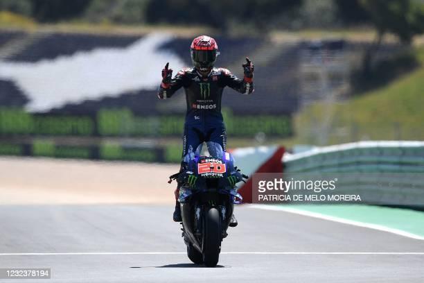 Monster Energy Yamaha MotoGP's French rider Fabio Quartararo celebrates after winning the MotoGP race of the Portuguese Grand Prix at the Algarve...