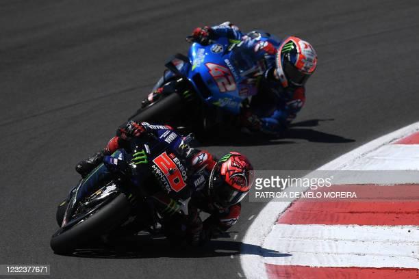 Monster Energy Yamaha MotoGP's French rider Fabio Quartararo and Team Suzuki Ecstar's Spanish rider Alex Rins compete in the MotoGP race of the...