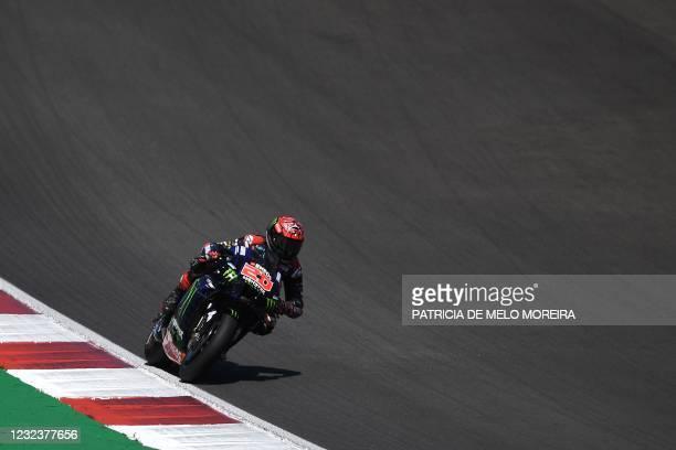 Monster Energy Yamaha MotoGP's French rider Fabio Quartararo competes in the MotoGP race of the Portuguese Grand Prix at the Algarve International...