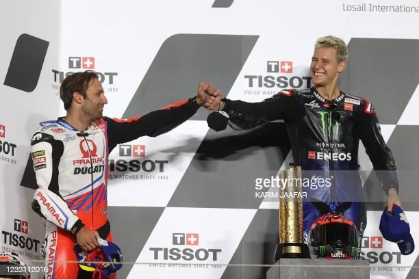 Monster Energy Yamaha MotoGP's French rider Fabio Quartararo is congratulated by Pramac Racing's French rider Johann Zarco for winning the Moto GP...