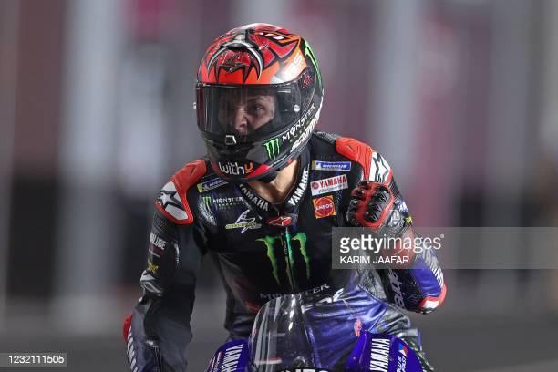Monster Energy Yamaha MotoGP's French rider Fabio Quartararo celebrates winning the Moto GP Grand Prix of Doha at the Losail International Circuit,...