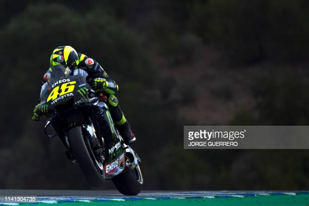Monster Energy Yamaha MotoGP's Italian rider Valentino Rossi rides during the warm up session ahead of the MotoGP race of the Spanish Grand Prix at...