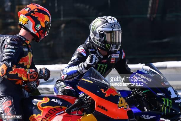 Monster Energy Yamaha Spanish rider Maverick Vinales celebrates next to Red Bull KTM Factory Racing Spanish rider Pol Espargaro after the Q2...