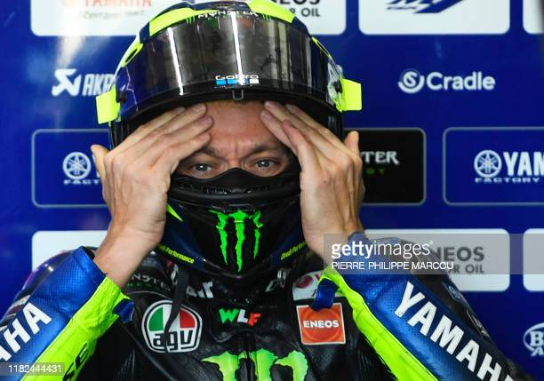 Monster Energy Yamaha's Italian rider Valentino Rossi adjusts his helmet during the first free practice of the Valencia Grand Prix, at the Ricardo...