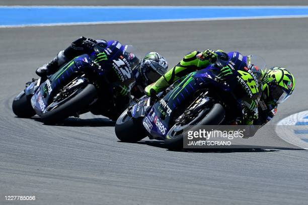 Monster Energy Yamaha's Italian rider Valentino Rossi and Monster Energy Yamaha's Spanish rider Maverick Vinales compete in the MotoGP race during...