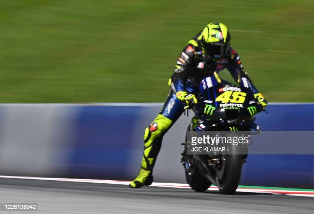 Monster Energy Yamaha's Italian rider Valentino Rossi brakes before a turn as he rides his bike during the first training round of the Moto GP...