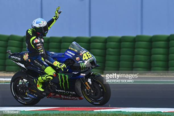 Monster Energy Yamaha's Italian rider Valentino Rossi gestures to the spectators after the qualifying session ahead of the Emilia Romagna MotoGP...