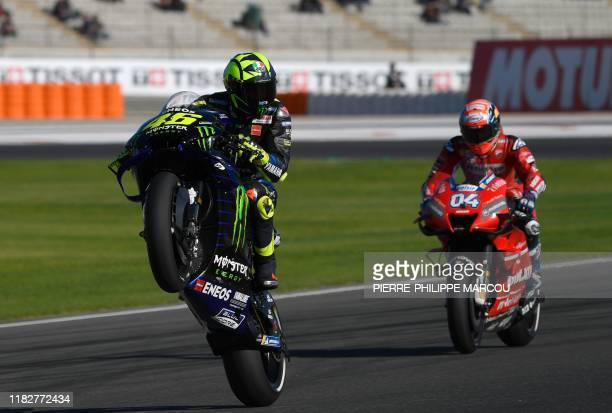 Monster Energy Yamaha's Italian rider Valentino Rossi makes a wheelie during the third free practice session of the MotoGP Valencia Grand Prix, at...