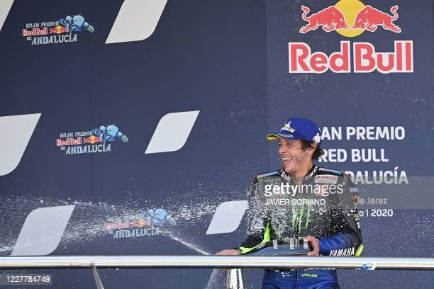 Monster Energy Yamaha's third-placed Italian rider Valentino Rossi celebrates on the podium after the MotoGP race during the Andalucia Grand Prix at...