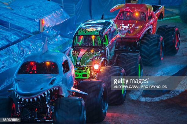 Monster trucks enter the arena during the Monster Jam show at the Verizon Center in Washington DC on January 28 2017 / AFP / Andrew CABALLEROREYNOLDS