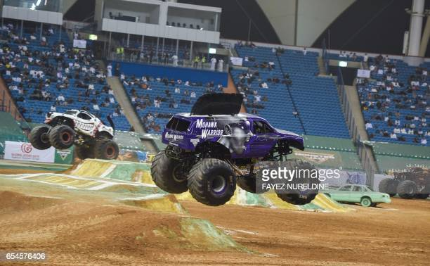 Monster trucks perform during the Monster Jam show at the King Fahad stadium in the Saudi capital Riyadh on March 17 2017 Monster Jam the USbased...