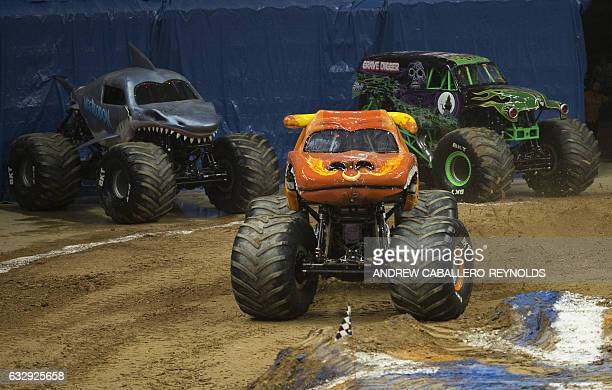 Monster trucks perform during the Monster Jam show at the Verizon Center in Washington DC on January 28 2017 / AFP / Andrew CABALLEROREYNOLDS