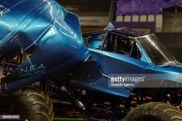 Monster trucks perform during the Monster Jam show in the first edition of Monster Jam in the Corinthians Arena in Sao Paulo Brazil on December 16...