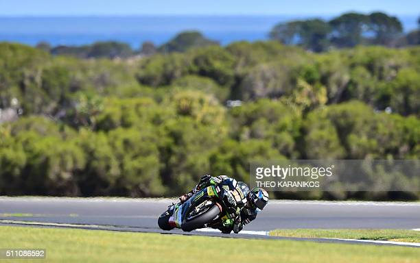 TOPSHOT Monster Yamaha Tech 3's English rider Bradley Smith takes a corner during the second day of 2016 preseason test on Phillip Island on February...