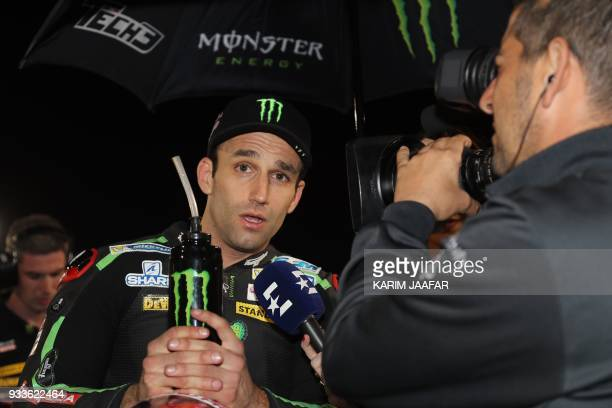 Monster Yamaha Tech 3's French rider Johann Zarco answers the press prior to the 2018 Qatar Moto GP Grand Prix at the Losail International Circuit in...