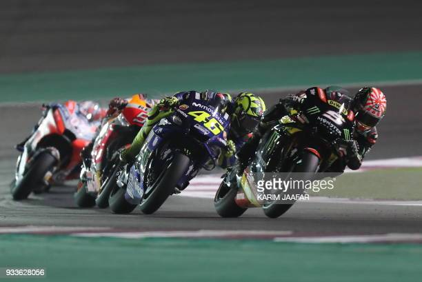 Monster Yamaha Tech 3's French rider Johann Zarco leads the pack ahead of Movistar Yamaha MotoGP's Italian rider Valentino Rossi during the 2018...