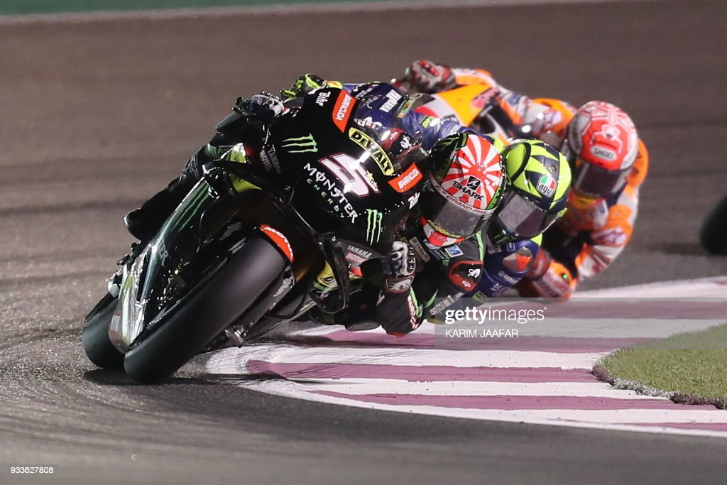 Monster Yamaha Tech 3's French rider Johann Zarco (1st-L) leads the pack during the 2018 Qatar Moto GP Grand Prix at the Losail International Circuit in Lusail, north of Doha, on March 18, 2018. /