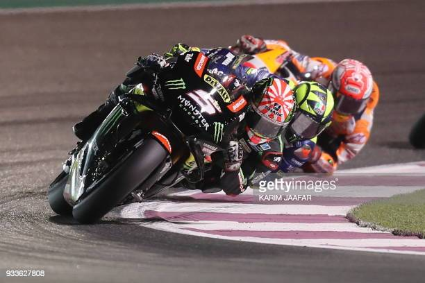 Monster Yamaha Tech 3's French rider Johann Zarco leads the pack during the 2018 Qatar Moto GP Grand Prix at the Losail International Circuit in...