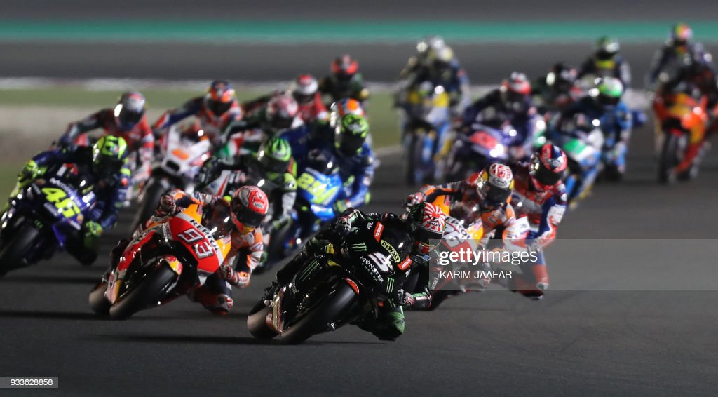 TOPSHOT - Monster Yamaha Tech 3's French rider Johann Zarco (number 5) leads the pack during the 2018 Qatar Moto GP Grand Prix at the Losail International Circuit in Lusail, north of Doha, on March 18, 2018. /