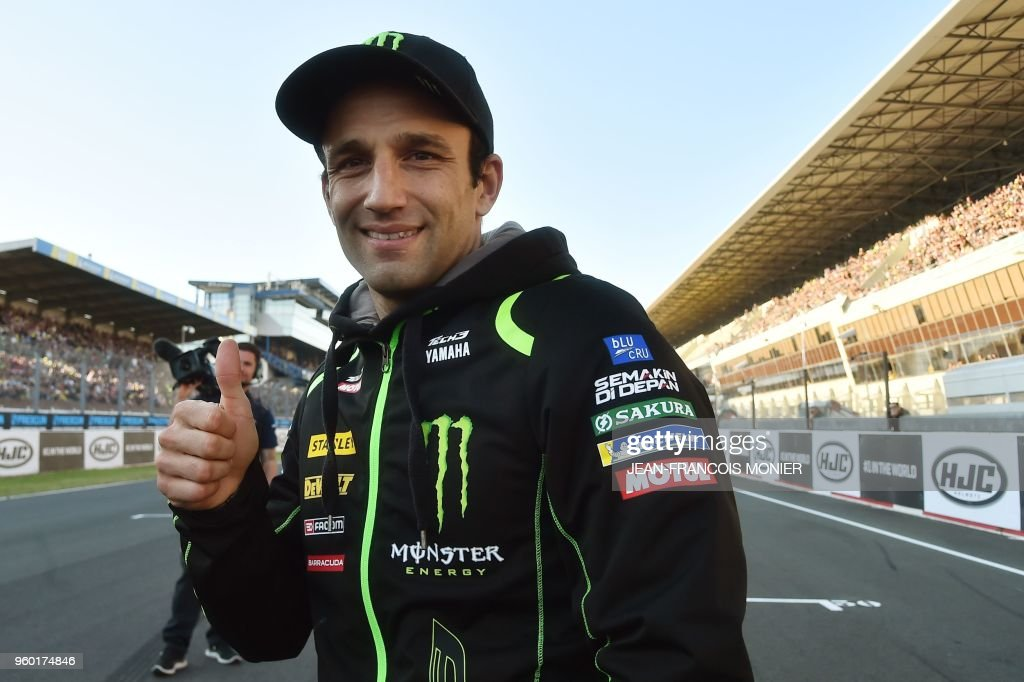 Monster Yamaha Tech 3's French rider Johann Zarco poses before giving the start of a race for young riders on the sidelines of the French MotorGP Grand Prix, on May 19, 2018 in Le Mans.