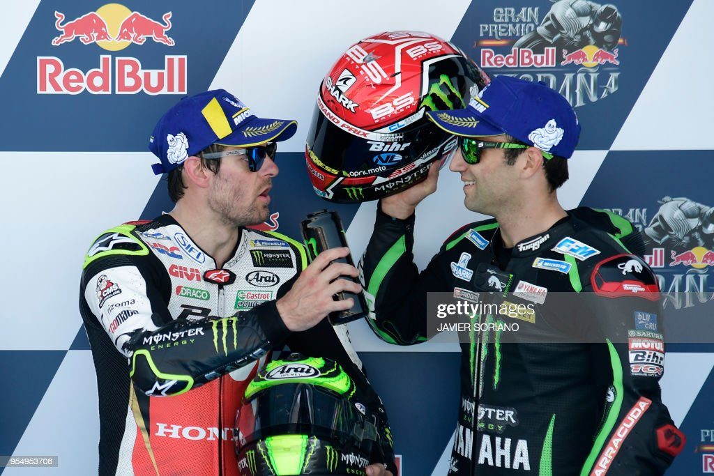 Monster Yamaha Tech 3's French rider Johann Zarco (R), third, speaks with LCR Honda's British rider Cal Crutchlow, first, after the MotoGP qualifying session of the Spanish Grand Prix at the Jerez racetrack in Jerez de la Frontera on May 5, 2018.