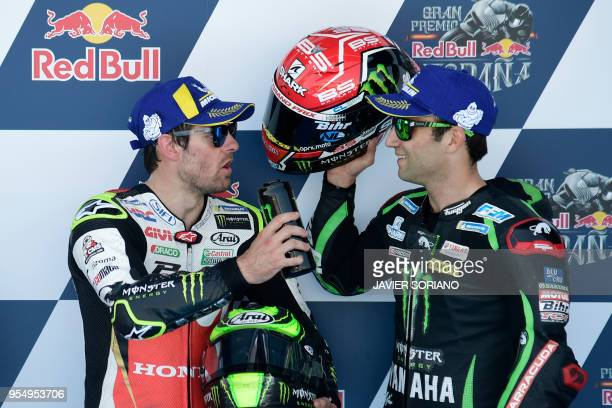 Monster Yamaha Tech 3's French rider Johann Zarco third speaks with LCR Honda's British rider Cal Crutchlow first after the MotoGP qualifying session...