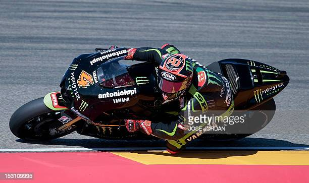 Monster Yamaha Tech3 team's Italian Andrea Dovizioso rides during the Moto GP race of the Aragon Grand Prix at Motorland's race track in Alcaniz on...