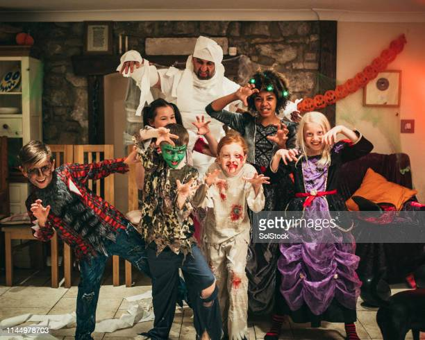 monsters out to play - naughty halloween stock photos and pictures