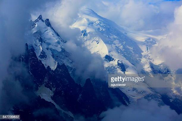 Mont Blanc alps and Aiguille du midi above clouds sunrise