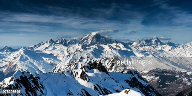 mont blanc and french alps in winter under cloudy sky, haute-savoie, rhone-alpes, france - auvergne rhône alpes stock pictures, royalty-free photos & images