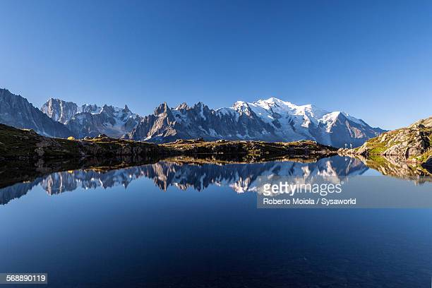 mont blanc and lake cheserys - mont blanc massif stock photos and pictures