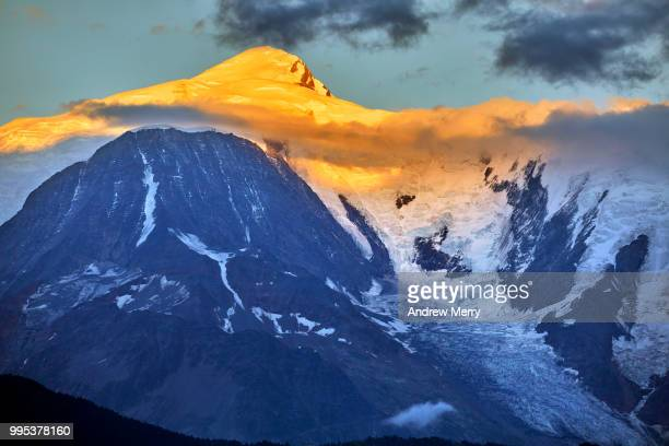 mont blanc at sunset with blue sky and clouds - pinnacle peak stock pictures, royalty-free photos & images