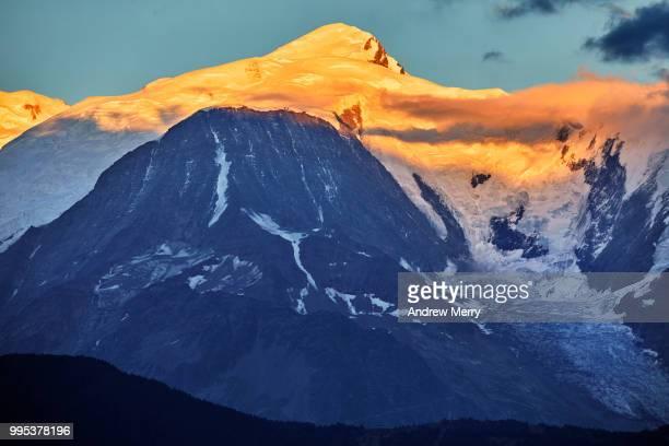 mont blanc at sunset with blue sky and clouds - pinnacle peak bildbanksfoton och bilder