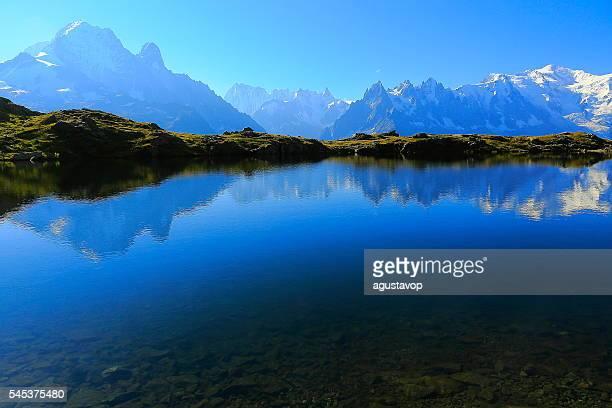 mont blanc massif, idyllic lake cheserys reflection, chamonix, french alps - reflection lake stock photos and pictures