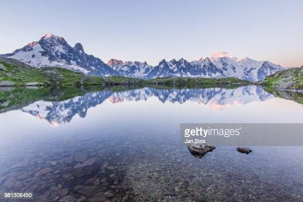 mont blanc reflected on mountain lake - mont blanc massif stock photos and pictures