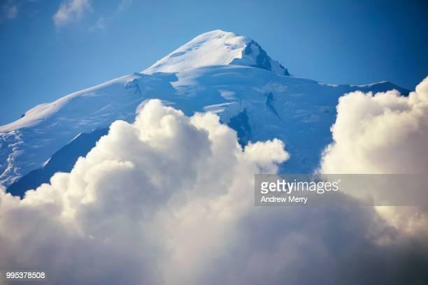 mont blanc snowcapped white peak, summit through cumulus clouds with blue sky sky - pinnacle peak bildbanksfoton och bilder
