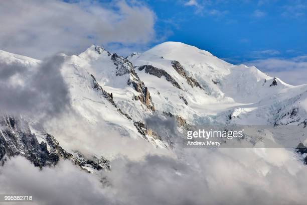 mont blanc summit, peak with clouds below and blue sky - pinnacle peak stock pictures, royalty-free photos & images