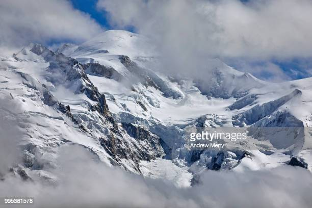 mont blanc with clouds partially obsuring the summit, peak, france - pinnacle peak stock pictures, royalty-free photos & images