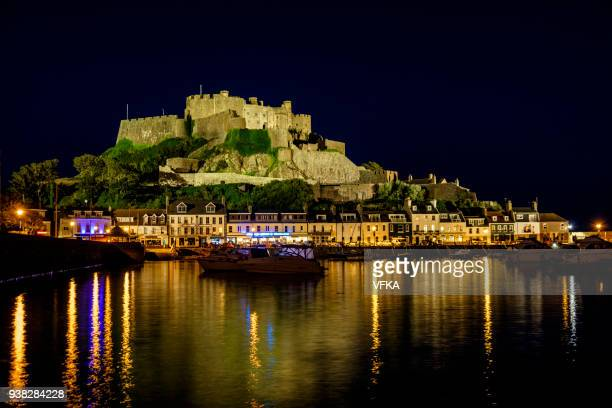 Mont Orgueil Castle,  Gorey Harbor and Pier at dusk, Gorey, Jersey, Channel Islands