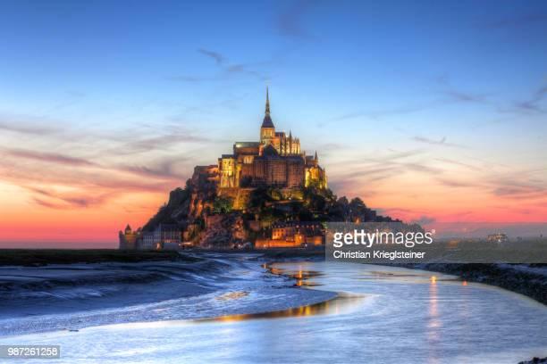 mont saint-michel at sunset in normandy, france. - モンサンミッシェル ストックフォトと画像